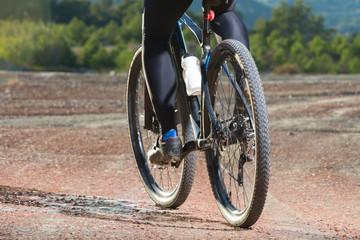 Low angle view of cyclist riding mountain bik
