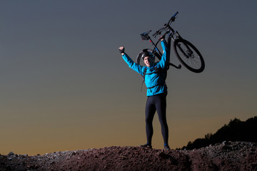 Cyclist celebrating making the top