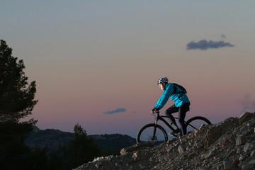 Mountain Bike cyclist down slope