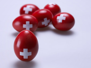 Eggs painted red with a white cross