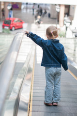 Cute little child in shopping center standing