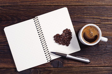 Coffee, heart and notepad