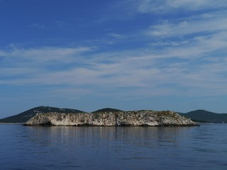 A rockl island in the Adriatic sea near the island Ist
