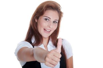 Junge sympathische Frau zeigt Daumen hoch und lächelt