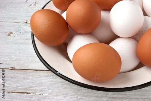 Keuken foto achterwand Egg Chicken eggs in the white plate on the white table
