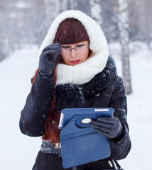 girl with digital tablet outdoors