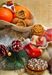 Christmas tangerines, lokum, pinecone and brittle candies on chr