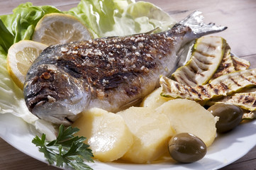 Roasted gilt-head sea bream with vegetables
