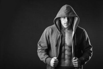 Young muscular man with open jacket