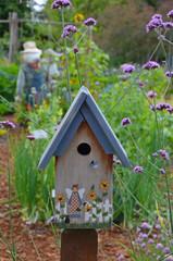 Decorative birdhouse in summer garden