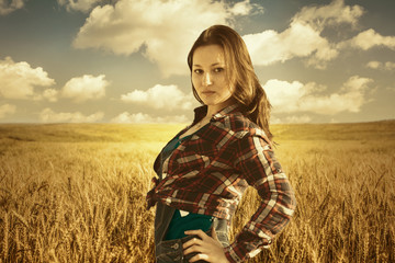 Attractive woman On Wheat Farm