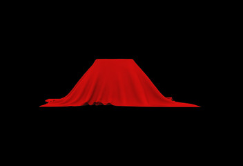 Object of rectangular shape covered with red cloth, on black