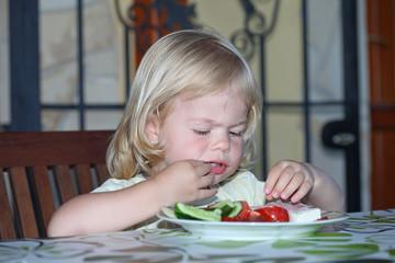 Sweet little girl having lunch