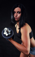 Sexy woman holding barbells