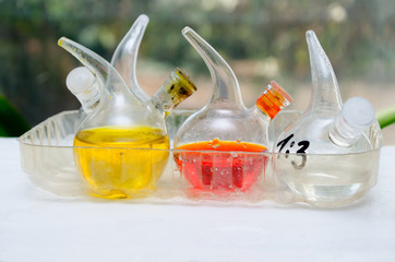 Chemical flasks filled with the chemical liquid