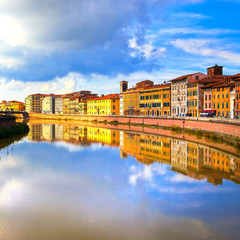 Pisa, Arno river and buildings reflection. Lungarno view. Tuscan