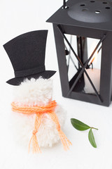 Snowman with a Top Hat and a Candle Lantern