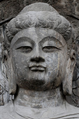 Buddha face sculpture of Longmen Grottoes in Luoyang, China.