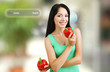 Shopping concept. Girl with fresh peppers on shop background