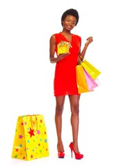African woman with shopping bags.