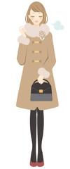 コートを着た女性 ため息