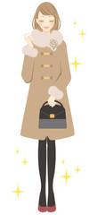 コートを着た女性 キラキラ
