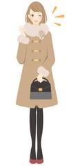 コートを着た女性 ウィンク