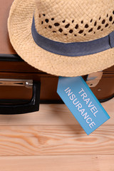 Travel suitcase with inscription travel insurance