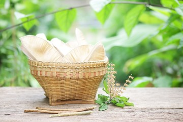 Grain basket on wooden table at outside