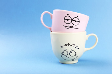 Emotional cups on blue background