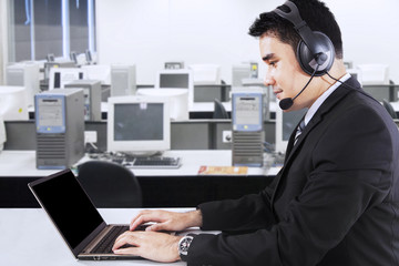 Businessman with headphone and laptop