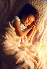 Cute little girl asleep at Christmas night