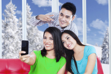 Cheerful people take self photo at home