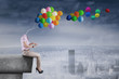 Girl with balloons head using tablet
