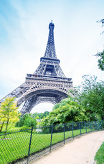 The Eiffel Tower and its magnificent gardens in summertime
