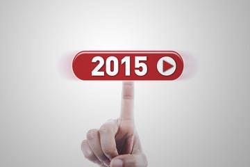 Hand clicking a futuristic button