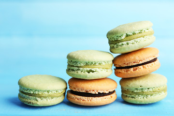 Gentle colorful macaroons on color wooden background