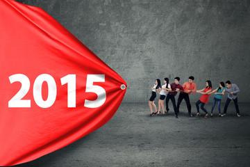 Hispanic business team drag number 2015