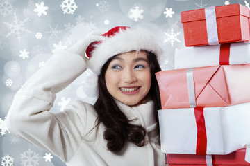 Hispanic girl holding presents boxes