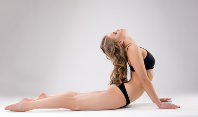 Image of flexible woman doing fitness exercise