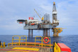 Offshore Jack Up Drilling Rig Over The Production Platform in Th