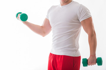 Athletic, strong man with dumbbell posing on a white background