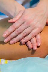 Masseur doing massage on woman body