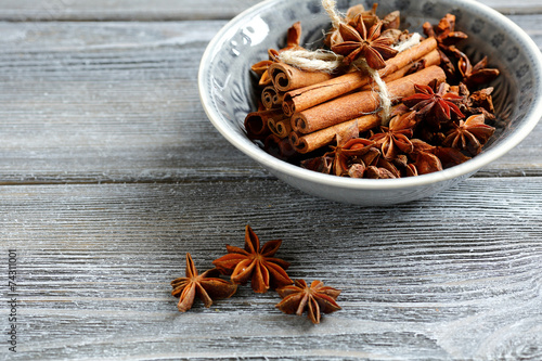 canvas print picture Cinnamon and star anise in small bowl
