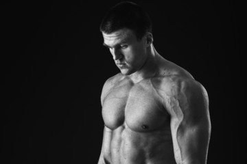 Man posing on a black background