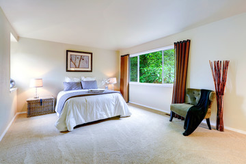 Bright master bedroom interior with brown curtains