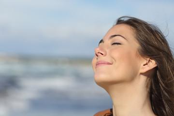 Closeup of a woman breathing fresh air on the beach
