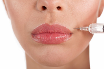 close up botox shot in the female lips,isolated