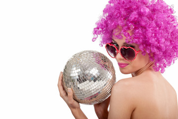 beautiful young girl with pink wig holding  disco ball,isolated