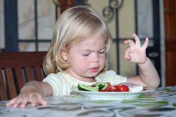 Sweet little blonde  girl having lunch